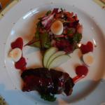 Warm smoked pigeon breast with raspberries and leaves