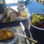 detail of breakfast: orange juice, brown bread and fresh fruit