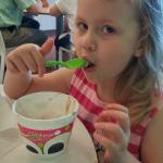 Enjoying her frozen yogurt