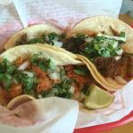 Set of Smoked Salmon Taco, Carnitas, and Barbacoa.  The Smoked Salmon taco was everything.