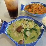 Delicious Green Thai Curry in foreground shown with Red Thai Curry with Tofu, and Thai Iced Tea.