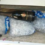 Cheap Sparkling Wine just sitting on top of bags of ice that were melting all over