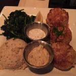 Crab cakes, cheese grits, sautéed spinach