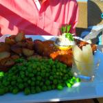 meat entre with peas and seared potatoes