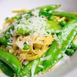 Lemon fettuccine with English, snap and sugar peas, tossed with butter and parmigiano