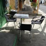 Small side walk seating outside.