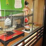 Glass encased  Samurai sword and other decorations.