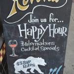 Happy Hour posted on the side walk Saturday 6/20 Evening
