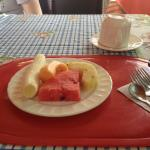 The first course of breakfast, they also serve eggs with a breakfast bread , juice and coffee