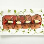 Wild fresh catch Ahi Tuna carpaccio, capers, anchovies, Taggiasche olives, quail eggs, chili pep