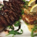 Serloin steak , grilled king prawns