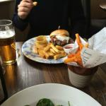 Burger and chips and side of sweet potato fries