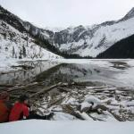 Enjoying lunch at the foot of frozen Avalanche Lake.