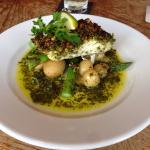 Special cod with a pistachio and Parmesan crust on a bed of new pots and asparagus with lemon he