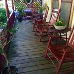 The adorable front porch of The Maples Inn