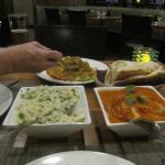 lamb biryani, rice, naan bread and chicken tikka massalla.