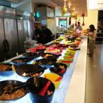 The savoury buffet, puddings and drinks around the corner