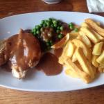 Chicken, peppercorn sauce , chips and peas.