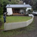 Playing croquet in front of our wee cottage, provided by Akaroa Cottages