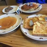 Tasty breakfast. Sausage patties, pancakes, and french toast