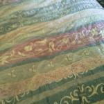 Old torn ya bedspread