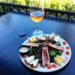 Glass of rose with our delicious salad nicoise.