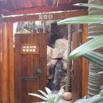 The wooden door separating the private yard from the hot spring area