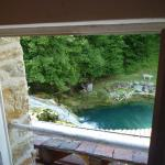 View of water fall and pool from bathroom (room#6)