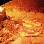pizzas in the wood burning oven