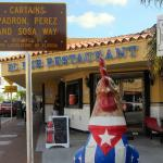 Corner cuban restaurant with Rooster wearing cuban flag!