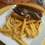 Sausage sandwich with fries