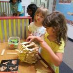 Girls building.