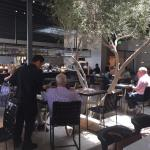 Inside the new Ollo Restaurant, with two of their signature dishes