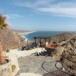 View of the grounds: fire pit, outdoor kitchen & beach