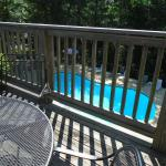 Balcony and tables above pool