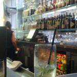 The bar with our mint julep and mojito in the foreground.