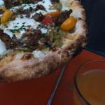 Lamb sausage pizza and local hard cider