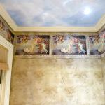 Botticelli's Venus wallpaper in the Empire Room bathroom