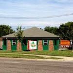 Look for the Irish Green & Brick building!