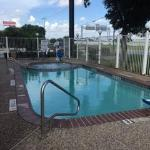 Pool next to highway and parking lot