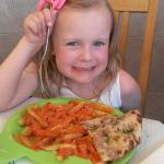 Our daughter with kids meal (Chicken Tikka Masala)