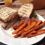 Ye-ha burger and Club Sandwich on brown both with sweet potato fries.