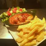 Lovely hunters chicken served with fresh salad and chips.