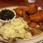 the seafood platter with spinach and baked potato