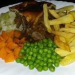 Steak and Ale pie, with home made chips and fresh veg.