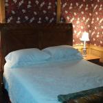 Queen sleigh bed minus decorative pillows