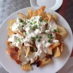 Homemade chips appetizer with blue cheese dressing.  Easily enough for three to share.
