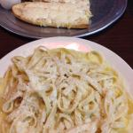 Alfredo Fettuccine that came with a side salad and bread. I also ordered the cheesy garlic bread