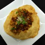 Chana Poori - A vegetarian dish consisting of chick pea curry (masala), with deep-fried flat bre