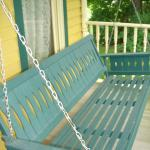 The swing on the hidden porch, just outside the formal parlor.